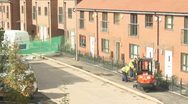 Construction worker cutting tarmac path Stock Footage