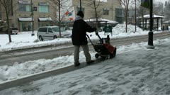 Clearing snow from sidewalk Stock Footage