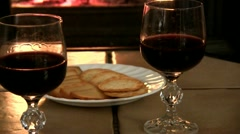 Wine and food by the fire - stock footage
