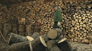 Stock Video Footage of Man Splitting Firewood in Woodshed Timelapse 1