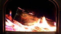Crackling fire in wood stove; 2 - stock footage