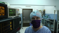 Portrait of surgeon looking at camera in clinic operation room Stock Footage