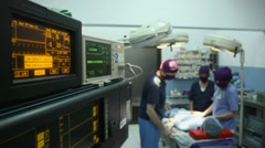Operation room in clinic with medical staff during surgery Stock Footage