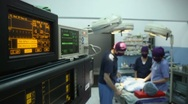 Stock Video Footage of Operation room in clinic with medical staff during surgery