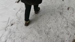 Follow girl walking on snow path first person view Stock Footage
