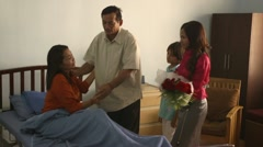 Woman hospitalized in private clinic with family and friends Stock Footage