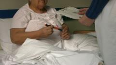 Sick diabetic women in hospital room Stock Footage