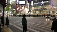 Stock Video Footage of Shibuya Tokyo   Pedestrians cross at Scramble Crossing