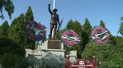 Monument with floral wreaths around it Stock Footage