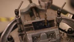 Drill press drilling metal block Stock Footage