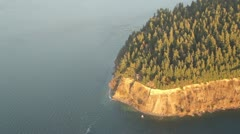 Aerial View of Trees and Cliffs on Wooded Peninsula Stock Footage