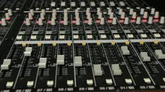 Hands all over audio console Stock Footage