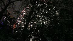 Huge Feris wheel from through trees Stock Footage