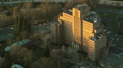 Hospital on Hillside at Sunset - Aerial Stock Footage