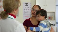 Doctor talking to a Hispanic mother Stock Footage