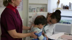 Trouble with the young patient Stock Footage