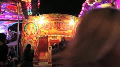 Fairground - magic mirror attraction with crowds passing by Stock Footage