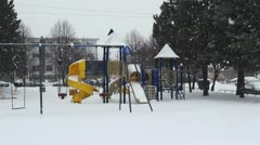 Snowing In Playground Stock Footage