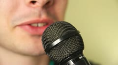 Young Man Talks To Microphone Stock Footage