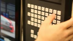 Entering information into CNC keyboard Stock Footage