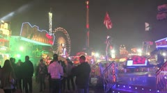 Fairground - crowds walk past camera- lads pull faces at camera towards end Stock Footage