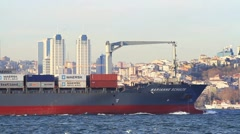 Large container ship sails in Bosporus waters Stock Footage