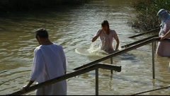 Pilgrims baptise in the Jordan River Holy Land Israel FULL HD Stock Footage