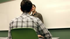 Teacher in front of class talking Stock Footage