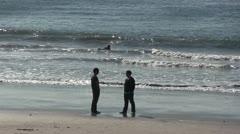 LA-0028 BEACH SCENE WITH NOVICE SURFER Stock Footage