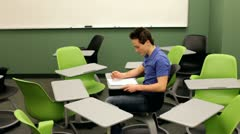 Student breaks away from chairs Stock Footage