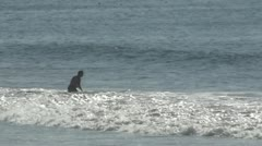 LA-0033 PADDLING SURFER AT VENICE BEACH Stock Footage