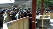 Stock Video Footage of Prayers, Offerings Given at Japanese Shinto Shrine