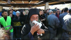 Greek Orthodox priest holds the pigeon of peace, Holy Land Israel FULL HD Stock Footage