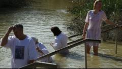Pilgrims baptise in the Jordan River Holy Land Israel FULL HD Stock Footage