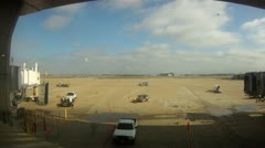 Dallas Fort Worth airport time lapse busy tarmac cutaway transition jobs working Stock Footage