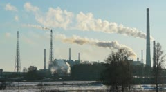 Smoke billows from factory, environmental pollution concept. Stock Footage