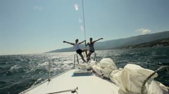 Young and happy family is traveling on a sail boat HD - stock footage
