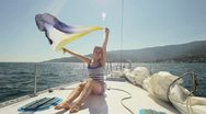 Stock Video Footage of Happy girl is on bow of the yacht  HD