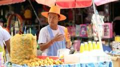Street Vendor of Orange jiuce in Bangkok Chinatown Stock Footage