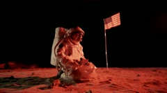 SLO MO, MS, ZI of an astronaut on Mars collecting a soil sample Stock Footage