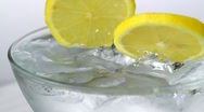 Lemon in glass of water, Slow Motion Stock Footage