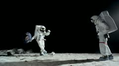 SLO MO, WS, Lockdown of two astronauts on the moon playing soccer Stock Footage