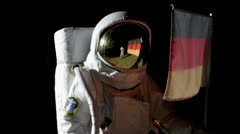 Shaky, CU, ZI, astronaut putting up an German flag on the moon and saluting Stock Footage