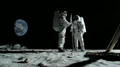 SLO MO, WS, Lockdown of two astronauts putting up an American flag on the moon Stock Footage