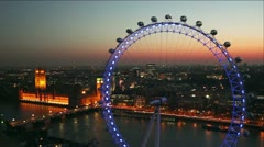 Stock Video Footage of London Eye and Houses of Parliament in London at dusk