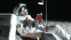 SLO MO, MS, Lockdown, astronaut on the moon sitting in a reclining chair, Stock Footage