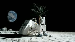 SLO MO, WS, two astronauts having leisure time on the moon Stock Footage