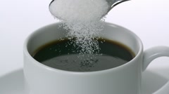 Sugar being poured into cup of coffee, Slow Motion Stock Footage