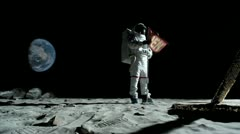SLO MO, WS, Lockdown of an astronaut putting up an OPEN flag on the moon Stock Footage