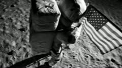 SLO MO, CU, astronaut putting up a American flag on the moon and saluting - stock footage